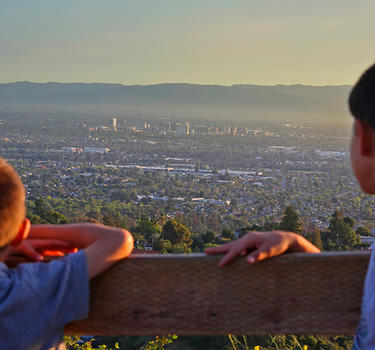 two kids overlooking San Jose from a lookout point on a trail in Alum Rock Park